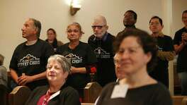 Members of the Alamo City Street Choir line up to perform during Sunday Service at Travis Park Methodist Church, Nov. 24, 2019. The choir is made up of homeless people.