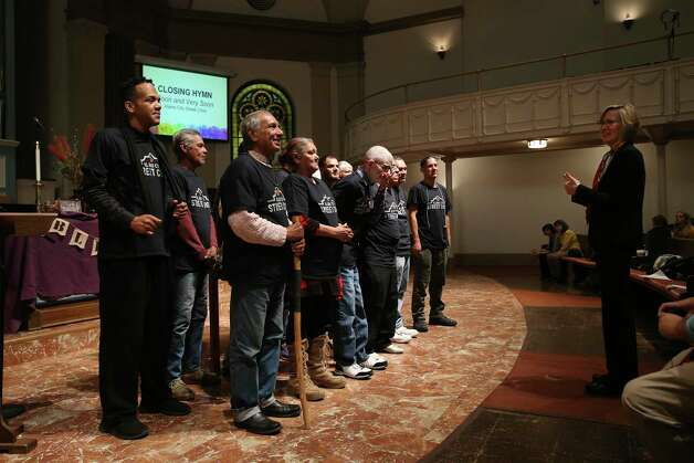 Members of the Alamo City Street Choir line up to perform during Sunday Service at Travis Park Methodist Church, Nov. 24, 2019. The choir is made up of homeless people and is directed by Tracy Bjella Powers, right. Photo: Jerry Lara, San Antonio Express-News / Staff Photographer / **MANDATORY CREDIT FOR PHOTOG AND SAN ANTONIO EXPRESS-NEWS/NO SALES/MAGS OUT/TV   © 2019 San Antonio Express-News