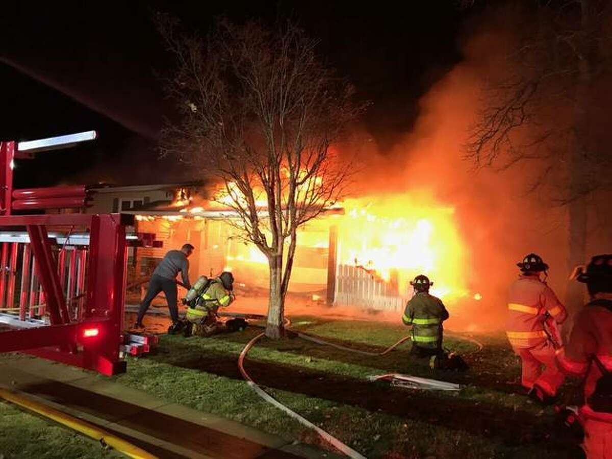 Jacksonville firefighters battle flames early Wednesday at a Baxter Place house.