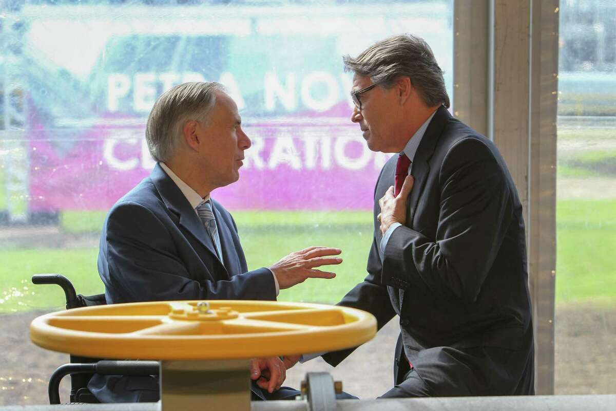Texas Govenor Greg Abbott and New Department of Energy Secretary Rick Perry chat after a ceremonial valve opening Thursday, April 13, 2017, in Richmond. NRG Energy celebrates the official opening of its Petra Nova carbon capture plant--which captures carbon from a coal-fired power plant. Technically the plant has been operational since late last year. Plant is the largest of its kind in the world. ( Steve Gonzales / Houston Chronicle )