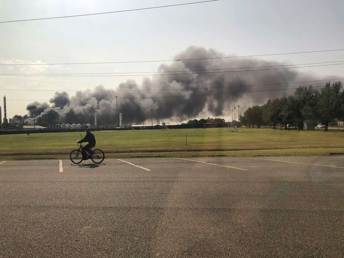 Smoke and fire is visible from the TPC Group Port Neches Operations explosion on Wednesday, Nov. 27, 2019, in Port Neches.