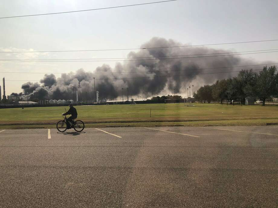 Smoke and fire is visible from the TPC Group Port Neches Operations explosion on Wednesday, Nov. 27, 2019, in Port Neches. Photo: Julie Garcia/Houston Chronicle