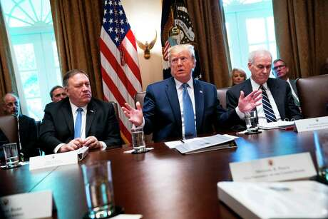 From left, Secretary of State Mike Pompeo, President Donald Trump, and Navy secretary Richard Spencer, then the acting Defense secretary, in a Cabinet meeting at the White House in Washington, July 16, 2019. Defense Secretary Mark Esper on Nov. 24 demanded the resignation of Spencer.