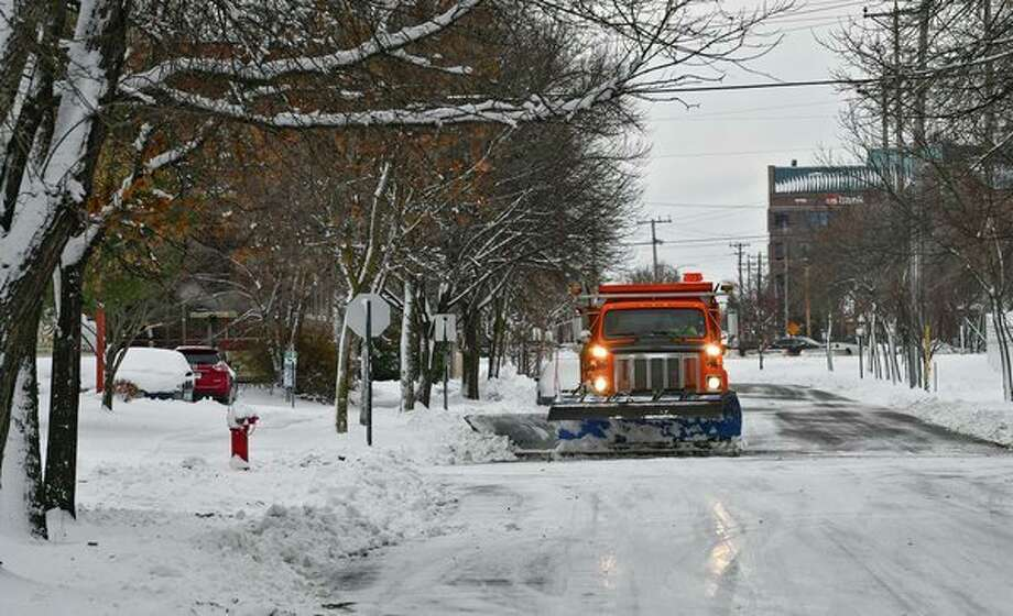 A snowplow removes about four inches of snow from a city street Wednesday, Nov. 27, 2019, in St. Cloud, Minn. According to the National Weather Service, St. Cloud received four inches of snow overnight. (Dave Schwarz/The St. Cloud Times via AP) / St. Cloud Times