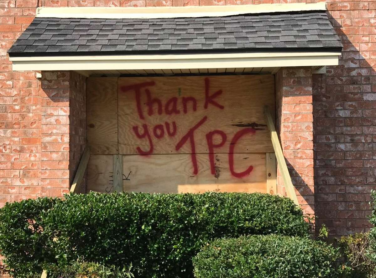 A boarded-up window in Mid-County following a Port Neches plant explosion Nov. 27, 2019.