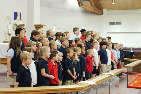 """Michaela Ingram, musical director for  St. Thomas the Apostle Episcopal School,  has spent the last two months preparing her choir of youngsters for a Dec. 12 performance of Handel's """"Messiah."""""""