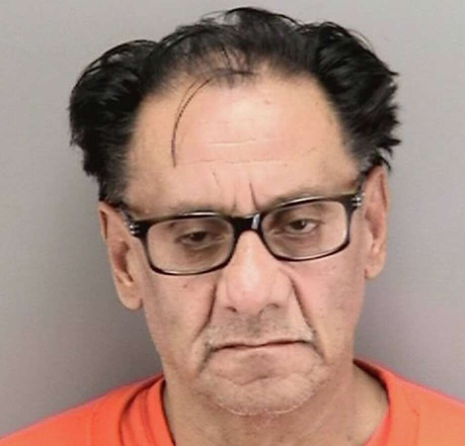 """Suspected """"Wedding Crasher"""" thief Mario Hernandez, 58, of Lancaster, Calif., was arrested Thursday, Nov. 21, 2019, at San Francisco Airport. He was booked into jail on multiple burglary and grand theft counts. Photo: San Francisco Police Department"""