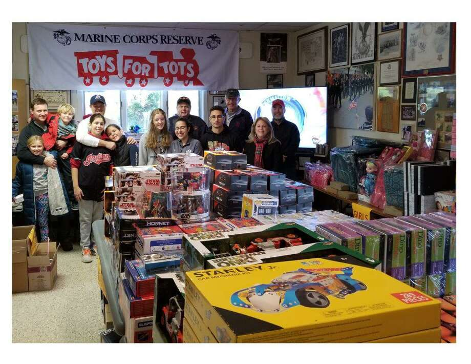 Wilton and Ridgefield members of the Marine Corps League have been collecting and sorting donations to Toys for Tots at the distribution hub in Ridgefield. The annual drive continues until Dec. 15. Photo: Henry Norley / Toys For Tots