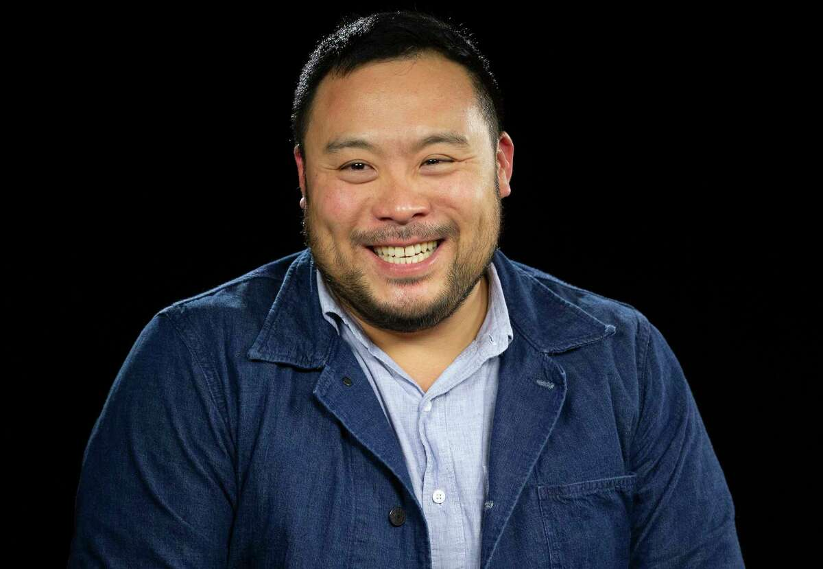This Oct. 23, 2019 photo shows celebrity chef David Chang during an interview in Los Angeles to promote his Netflix series a€œBreakfast, Lunch & Dinnera€. (AP Photo/Damian Dovarganes)