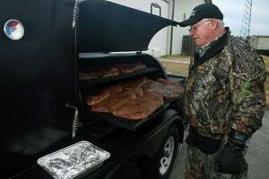 "Montgomery United Methodist Church Cooker Kenny Maggard checks on briskets during their ""cook to build supply"" outing at Montgomery United Methodist Church on Nov. 23, 2019."