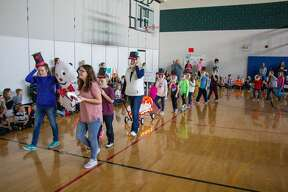 Despite a school-wide power outage the students and staff at Laker Elementary celebrated Thanksgiving Nov. 27 by hosting a Macy's-style parade with helium filled characters. Each class paraded around the gymnasium with wagon sized floats and inflatable characters from a variety of stories.