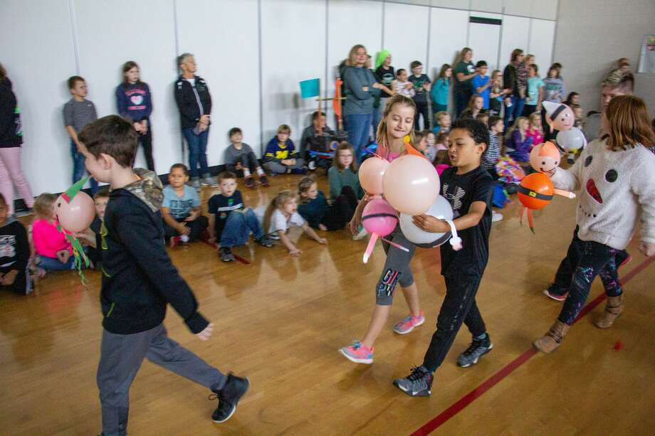 Despite a school-wide power outage the students and staff at Laker Elementary celebrated Thanksgiving Nov. 27 by hosting a Macy's-style parade with helium filled characters. Each class paraded around the gymnasium with wagon sized floats and inflatable characters from a variety of stories. Photo: Scott Nunn/Huron Daily Tribune