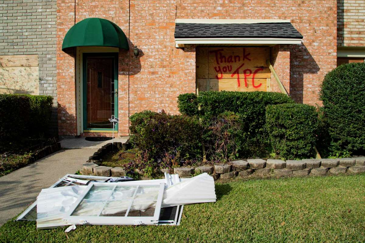 """Making reference to being Thanksgiving week, Brian Kessel sprayed """"Thank you, TPC"""" on the panels he placed in the morning to cover the windows that shattered during the TPC Group Port Neches Operations explosion on Wednesday, Nov. 27, 2019, in Port Neches. Kessel has been living across from the plant since 2010 and at the moment of the explosion he was on his couch below the windows that shattered. He said he is unharmed."""