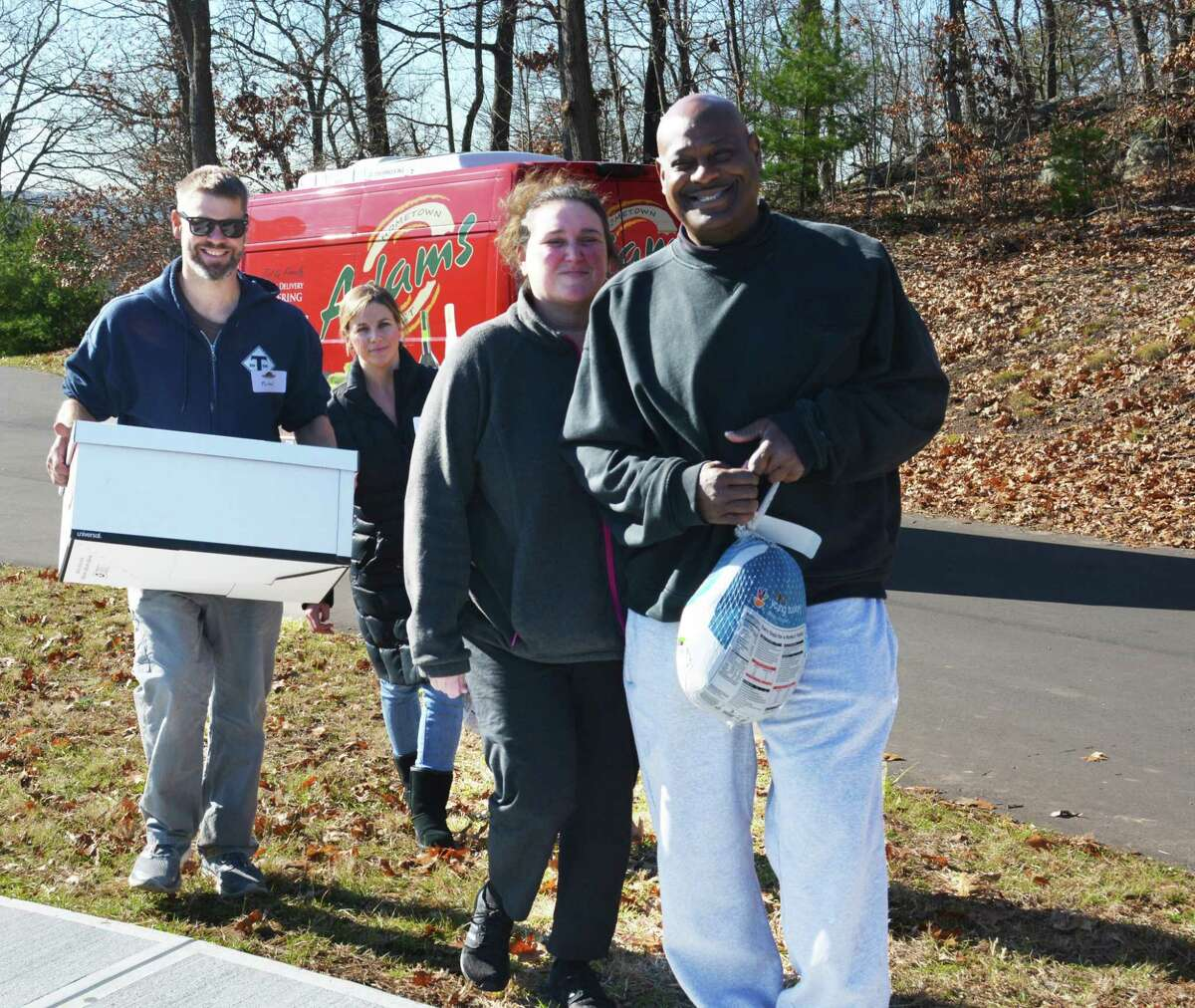 Middletown Community Thanksgiving Project volunteers insist on carrying boxes of food to the vehicles of those who used the service this year at Fellowship Church.