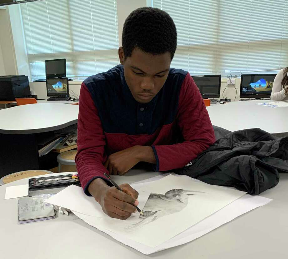 Rafaque Hughes at work on his rhinocerous drawing in art class. l Photo: Contributed / Contributed Photo / Westport News contributed