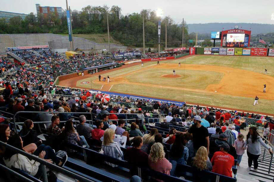 In this April 4, 2019, file photo, fans watch the Chattanooga Lookouts play the Montgomery Biscuits at AT&T Field in Chattanooga, Tenn. Major League Baseball is pushing a proposal to eliminate 42 teams — and several entire leagues — from its vast network of minor-league affiliates that bring the game to every corner of country. At the same time, Minor League Baseball has announced that it will partner with Stamford-based Octagon on a media-distribution strategy. Photo: C.B. Schmelter / Associated Press / Chattanooga Times Free Press