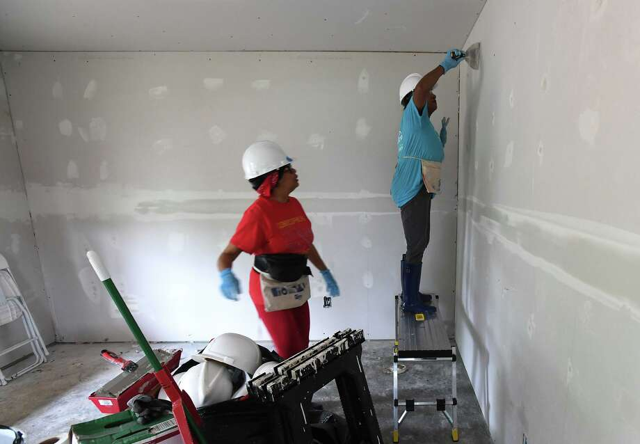 From right, Sharon Dogier-Davis and Carla Allen work Wednesday on a Beaumont home during the Habitat for Humanity's Women's Build event. The event provides a home for a family while raising awareness for female workers and highlighting that women are the main recipients of Habitat homes. Photo taken Wednesday, 5/8/19 Photo: Guiseppe Barranco/The Enterprise, Photo Editor / Guiseppe Barranco ©