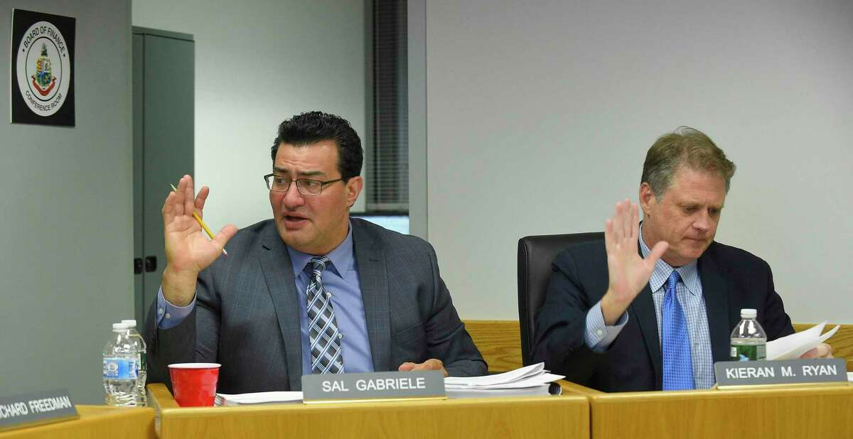 Republican Sal Gabriele, at left, votes a motion, one of his final acts as a member of the City of Stamford's Board of Finance during a the monthly BOF's public meeting at the Government Center on Nov. 14, 2019 in Stamford, Connecticut. Gabriele is leaving the Board of Finance in the middle of his term because of work commitments. Gabriele, who has been an elected official for 12 years, started on the Board of Representatives, where he made headlines for calling out nepotism, the scrap metal scandal, and lack of government transparency. Seated with Gabrielle is Kiernan Ryan.