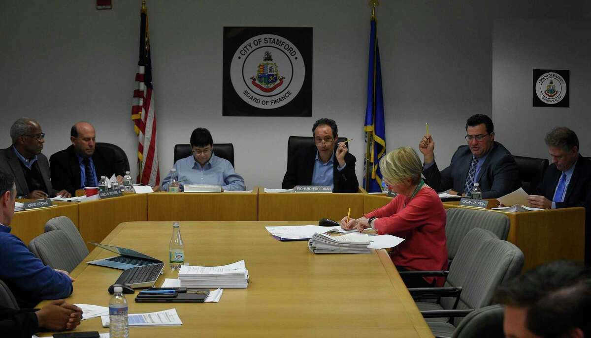 Republican Sal Gabriele, second from right, seconds a motion, one of his final acts as a member of the City of Stamford's Board of Finance during a the monthly BOF's public meeting at the Government Center on Nov. 14, 2019 in Stamford, Connecticut. Gabriele is leaving the Board of Finance in the middle of his term because of work commitments. Gabriele, who has been an elected official for 12 years, started on the Board of Representatives, where he made headlines for calling out nepotism, the scrap metal scandal, and lack of government transparency. Seated with Gabrielle is Kiernan Ryan.
