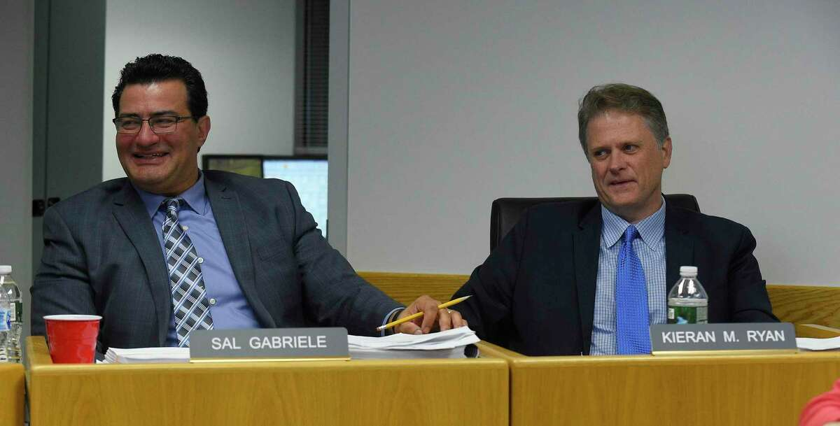 Republican Sal Gabriele, at left, is recognized during City of Stamford's Board of Finance public meeting at the Government Center on Nov. 14, 2019 in Stamford, Connecticut. Gabriele is leaving the Board of Finance in the middle of his term because of work commitments. Gabriele, who has been an elected official for 12 years, started on the Board of Representatives, where he made headlines for calling out nepotism, the scrap metal scandal, and lack of government transparency. Seated with Gabrielle is Kiernan Ryan.
