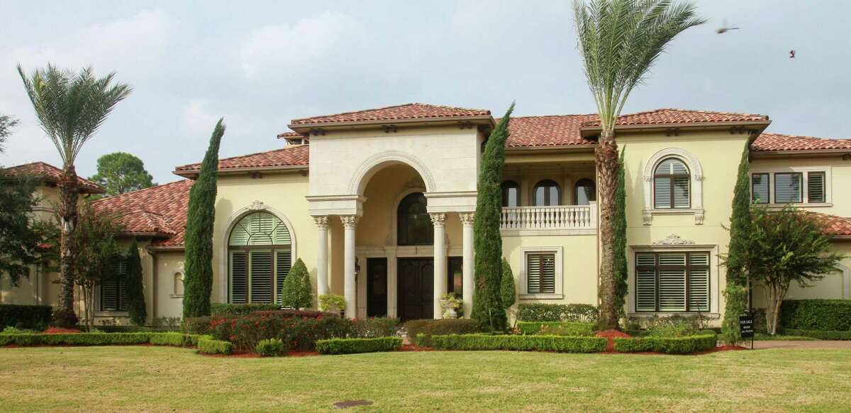 This house in at 11010 N Country Squire Street in Piney Point Village was sold at a luxury property auction.