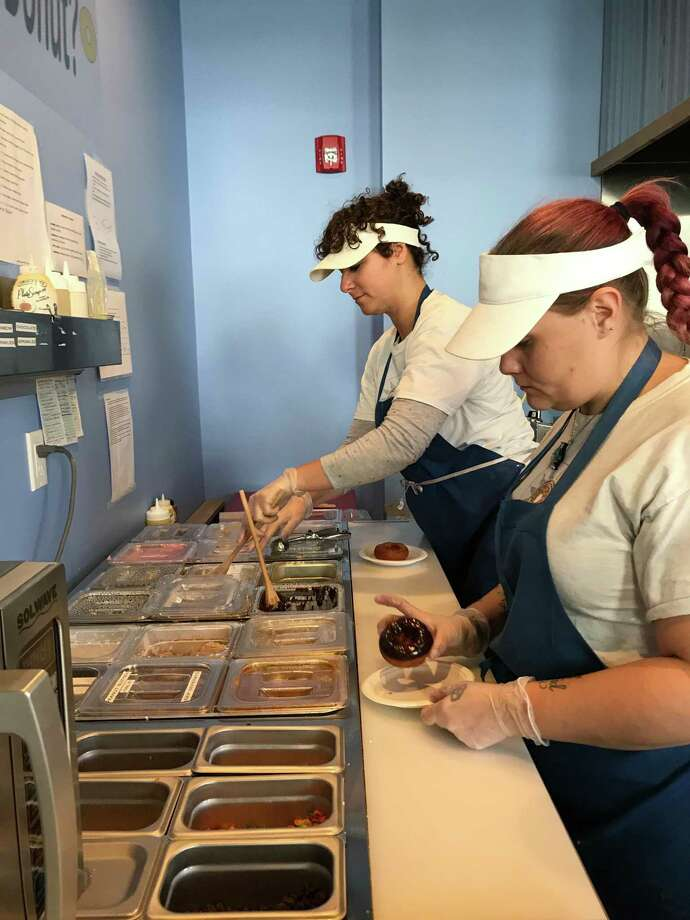 Blazing Fresh Donuts staff work to create some sweet treats at the Guilford store on Nov. 26, 2019. Photo: Contributed Photo / Jodi Burns