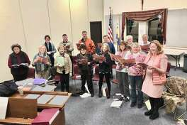 Our Lady of Fatima's Adult Choir practices for its annual Advent concert on Dec. 15.