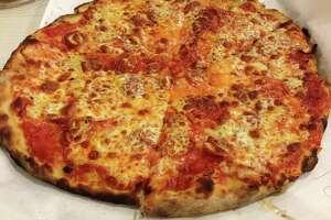 A tomato and mozzarella pizza from Frank Pepe Pizzeria Napoletana in New Haven.