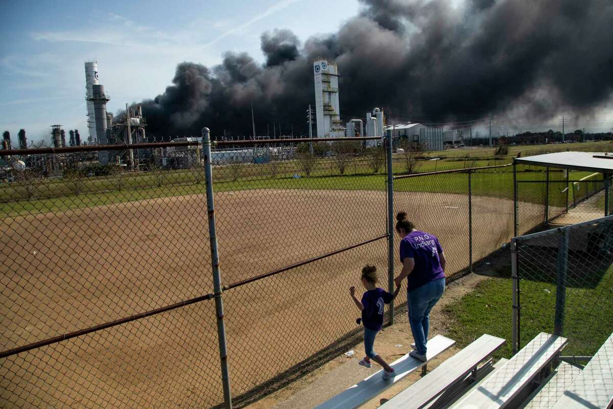 Cloud of smoke on the background from the TPC Group Port Neches Operations explosion is visible from a little league baseball park on Wednesday, Nov. 27, 2019, in Port Neches.