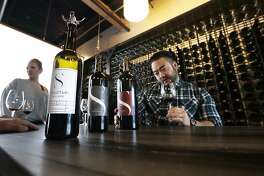 Mike Roh sniffs wine before tasting it at Structure Cellars wine tasting room in Seattle, Wash., on Thursday, Nov. 21, 2019 . From less than 20 wineries in 1981, the Washington wine industry has grown to more than 1,000 this year. The state is the second-largest producer of premium wines in the U.S., trailing only California.