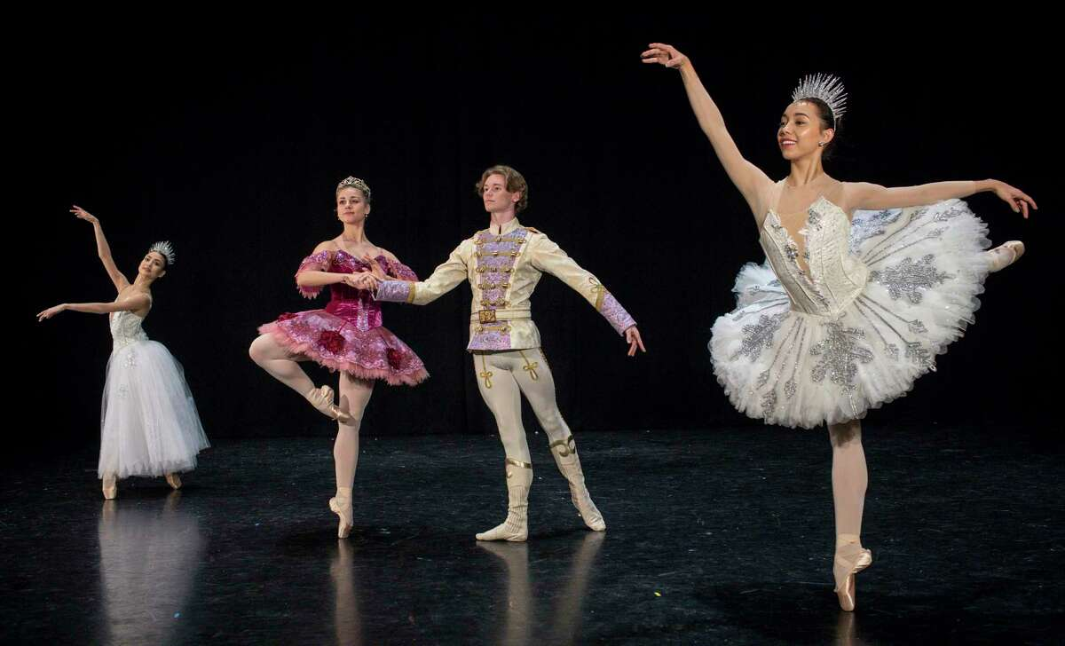 Gretel Batista, from left, Tyler Donatelli, Chandler Dalton and McKhayla Pettingill pose for a photo at the Houston Ballet Center for Dance on Thursday, Nov. 21, 2019, in Houston. The four dancers will have prominent roles in Houston Ballet's
