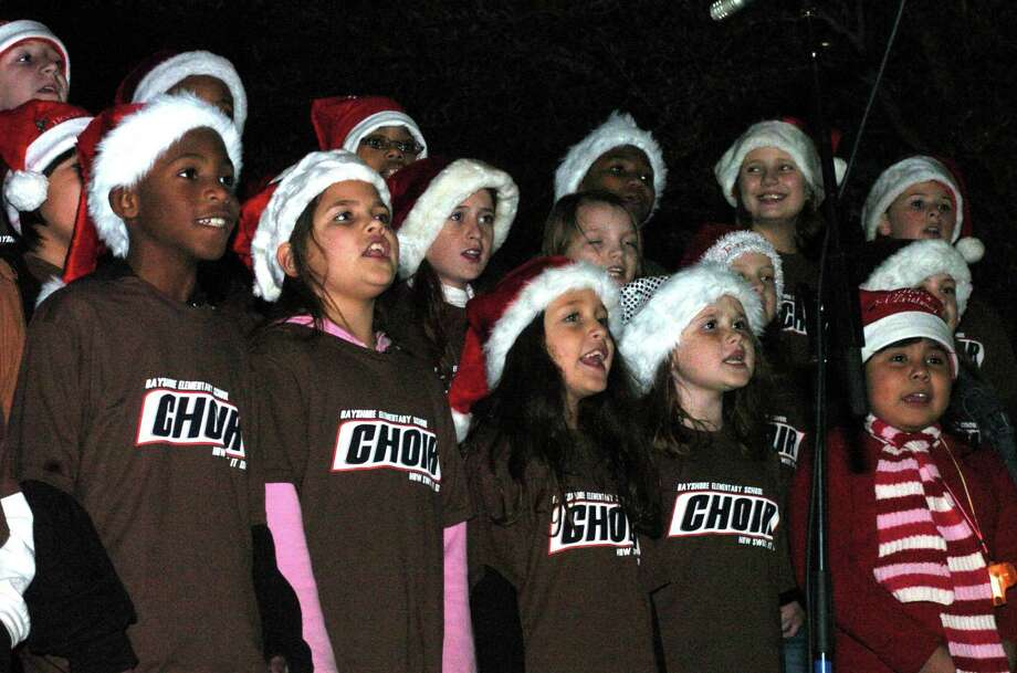 Christmas on Main Street is a longtime La Porte tradition. Here, the Bayshore Elementary School Choir performs in 2007. This year's event is set for Dec. 5 and will include musical performances from students in La Porte Independent School District. The event also will include vendors selling Christmas goodies and gifts, the lighting of the Christmas tree and, of course, pictures with Santa Claus. Photo: Kirk Sides, Freelance / For The Chronicle / Freelance