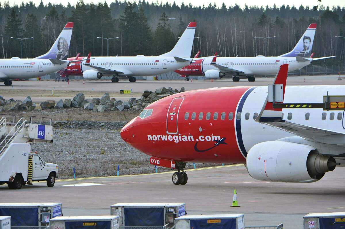 (FILES) This file photo taken on March 5, 2015 shows aircrafts of Norwegian low-cost airline Norwegian Air Shuttle on the tarmac at Arlanda airport in Stockholm, Sweden. +++ SWEDEN OUT +++ The battle is on in Barcelona, Spain's popular Mediterranean city where two airlines have started competing for passengers in the emerging trend of low cost, long-haul flights. A first flight operated by Level, a new carrier created by IAG, the parent company of British Airways and Spain's Iberia, took off on June 1, 2017 from El Prat airport to Los Angeles. The airline also flies to San Francisco, Buenos Aires and Punta Cana in the Dominican Republic. Meanwhile Norwegian, a pioneer in cheap long-distance flights, takes off from on June 5, 2017 to New York, Los Angeles, Miami and San Francisco. / AFP PHOTO / TT NEWS AGENCY / JOHAN NILSSONJOHAN NILSSON/AFP/Getty Images