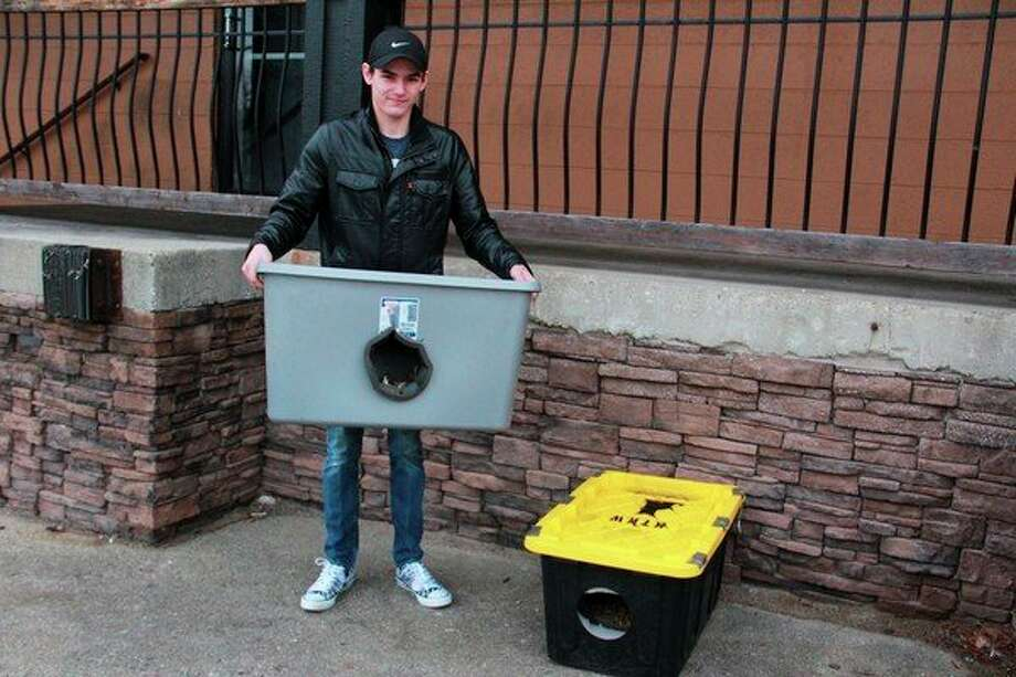 Big Rapids resident Brenden Larie sets up a few homes for stray cats in the area. Larie said he hopes the homes will provide homeless felines with a warm place to stay during the winter nights. (Pioneer photo/Alicia Jaimes)
