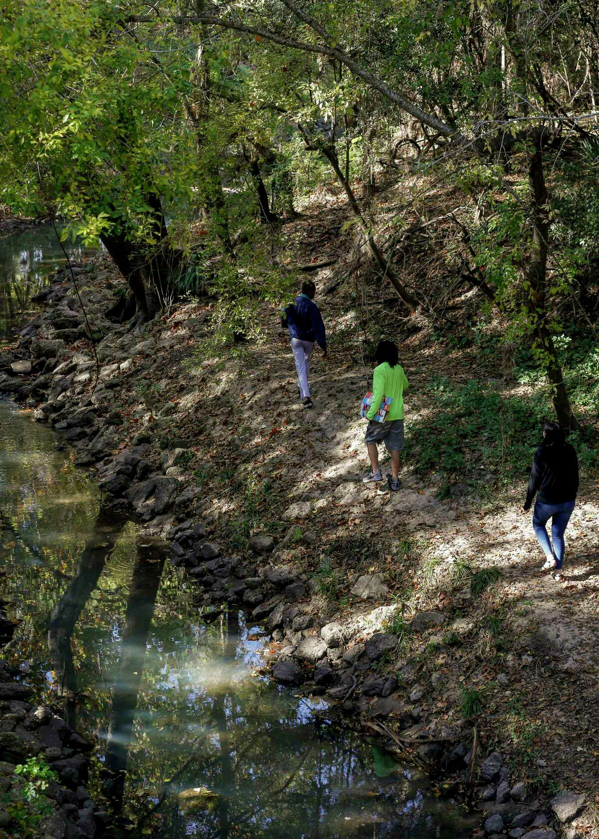 People enjoy the Edith L. Moore Nature Sanctuary.