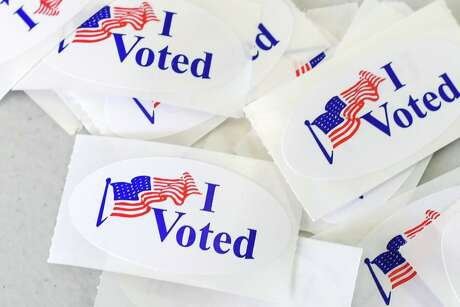 """""""I Voted"""" stickers at a polling station on the campus of the University of California, Irvine, on November 6, 2018, in Irvine, Calif. (Robyn Beck/AFP/Getty Images/TNS)"""