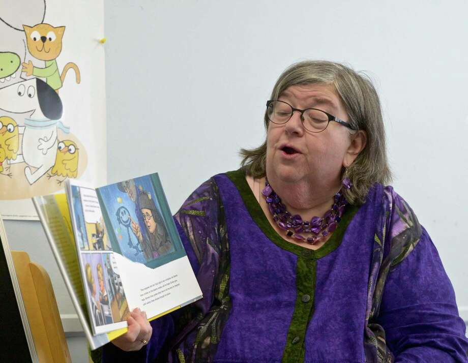 Sue Ford, Children's Librarian, reads a book during a children's program for the New Milford Library held in the First Congregational Church parish hall. The library's children's programs have been held at the hall while the library goes through its modernization project. Tuesday, November 26, 2019, in New Milford, Conn. Photo: H John Voorhees III / Hearst Connecticut Media / The News-Times