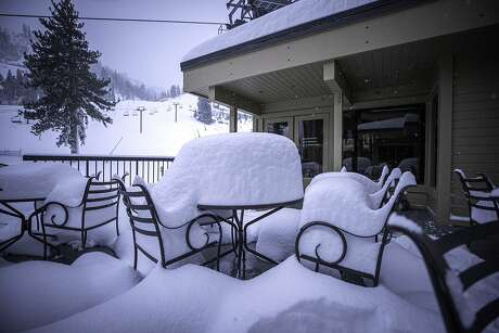 The scene Wednesday morning at Squaw Valley, where fresh snow piled high at the courtyard, and allowed Squaw-Alpine to open an additional lift and terrain for Thanksgiving