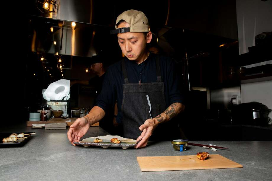 Sous chef Rich Lee prepares the Sot L'y Laisse (thigh oyster, chicharron, osetra caviar) at Hina Yakitori in S.F. Photo: Santiago Mejia / The Chronicle