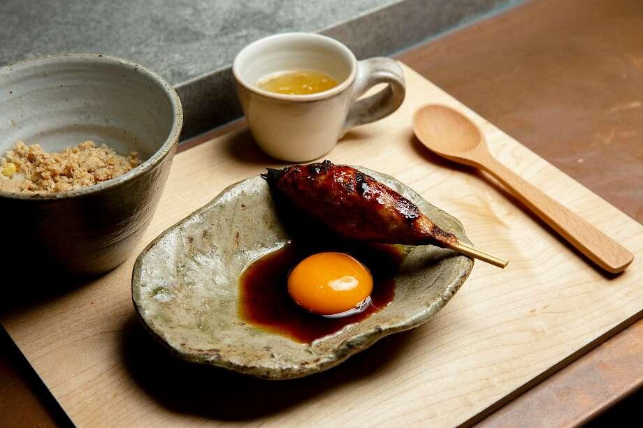 Tsukune (meatball, tare, yolk) at Hina Yakitori in S.F. Photo: Santiago Mejia / The Chronicle