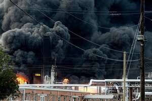Thick smoke fills the sky above the TPC plant in Port Neches as emergency response crews try to contain the fire that continued to burn throughout the morning following an overnight explosion. Several homes and businesses and Port Necehs High School and other city buildings suffered damage from the blast. Photo taken Wednesday, November 27, 2019 Kim Brent/The Enterprise