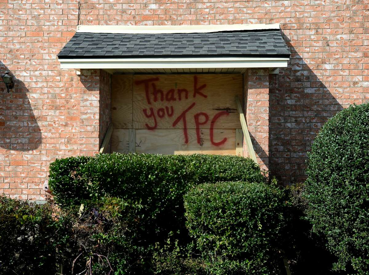 A boarded up window at a townhome on Merriman Road bears a message for TPC Group as residents and business owners throughout Port Neches clean up from the damage caused by Wednesday morning's explosion at the plant. Photo taken Wednesday, November 27, 2019 Kim Brent/The Enterprise