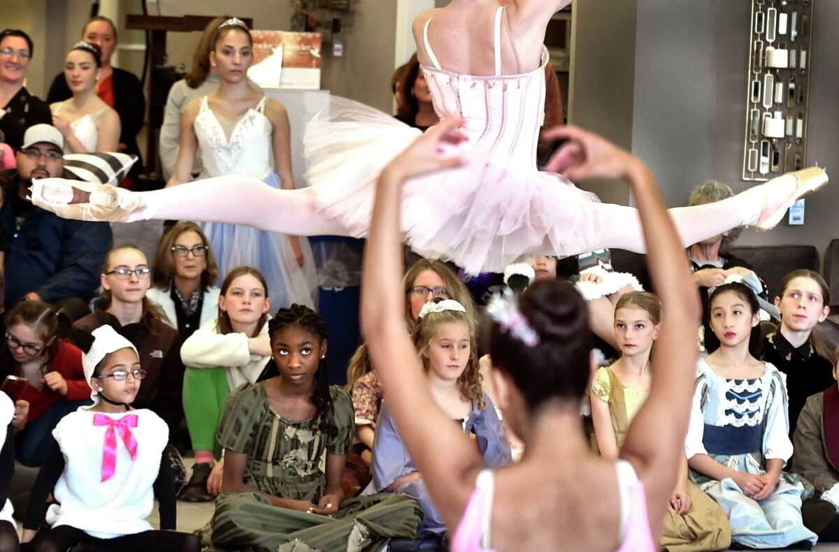 STORE VENUE: A ballerina goes airborne as the New Haven Ballet dancers perform excerpts from