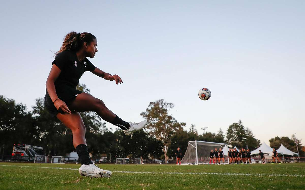 Stanford soccer player Catarina Macario kicks a goal from the sidelines during practice with her team at Stanford University on Thursday, Nov. 21, 2019, in Stanford, Calif.