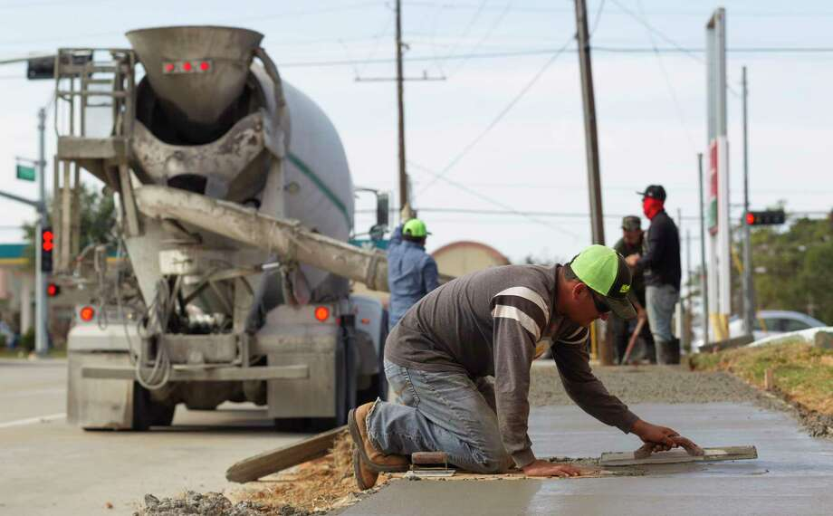 Concrete is poured for sidewalks as part of the Bus Livability Grant along Wilson Road near Frazier Street, Wednesday, Nov. 27, 2019, in Conroe. The $2.1 million grant from the Department of Transportation emphases pedestrian access and safety along roadways. Photo: Jason Fochtman, Houston Chronicle / Staff Photographer / Houston Chronicle