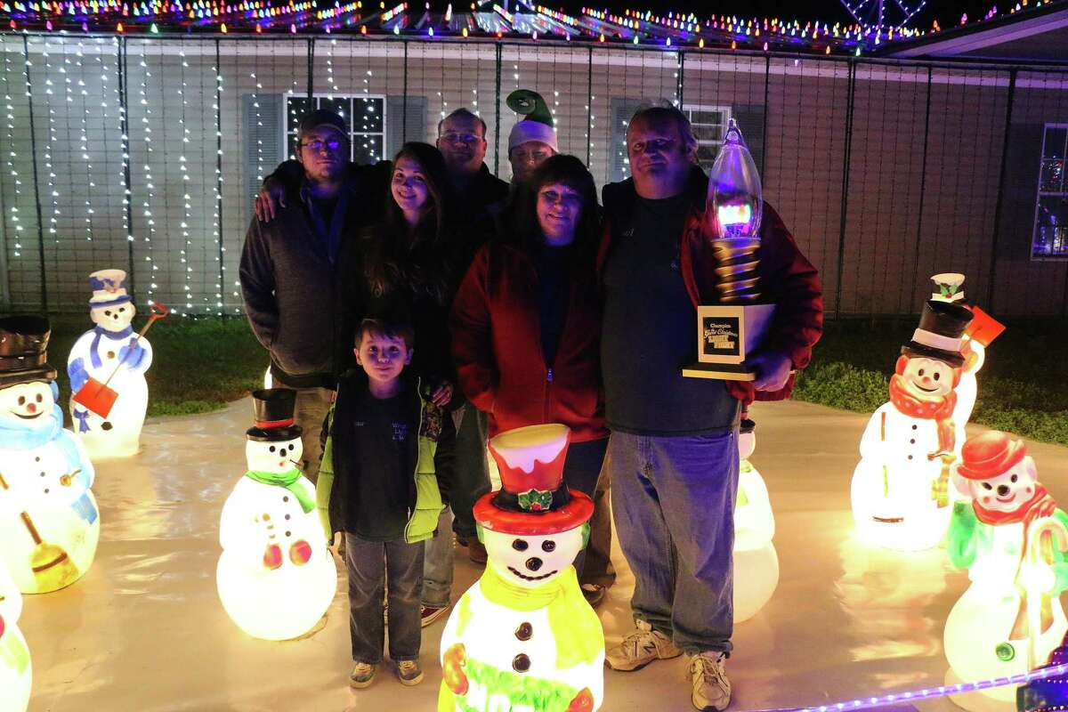 The Wright family proudly shows of the trophy they were awarded for their winning Christmas display on ABC's The Great Light Fight back in 2017. They won a $50,000 prize for their display.