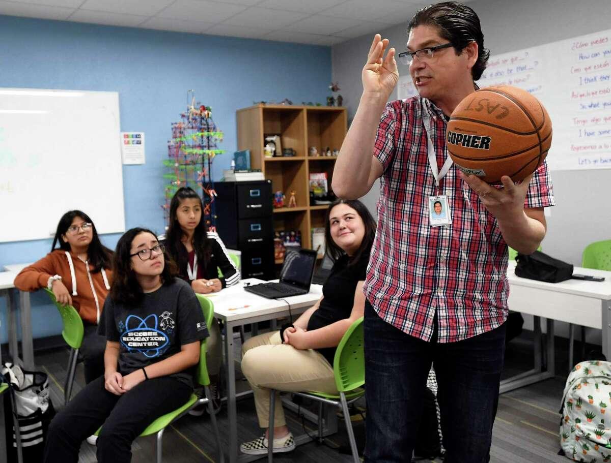 In 2019, Oscar Garcia, a math teacher at CAST Med High School, uses a basketball to explain parabolic curves. A reader has nothing but praise for public school teachers.