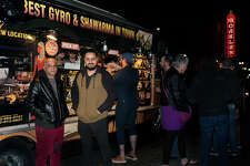 A surprising night scene gathers around a popular falafel truck in Oakland.