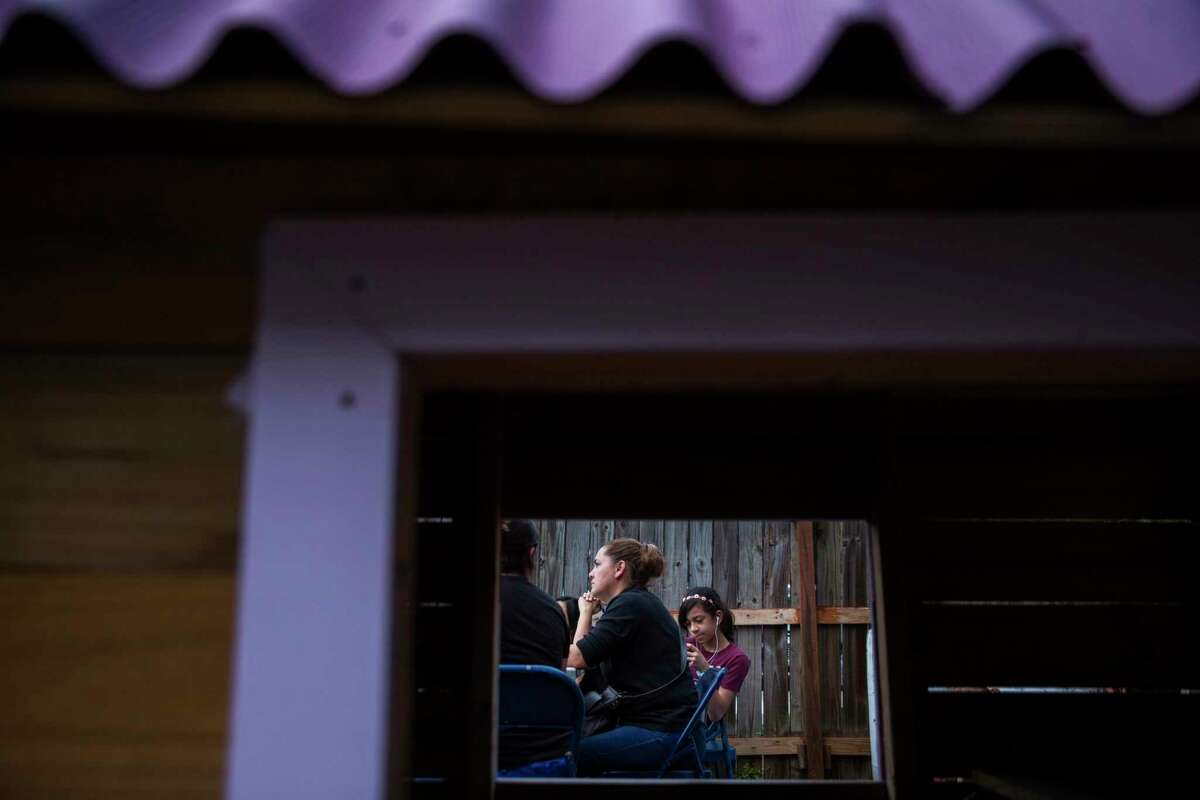 Maria Campos, mother of four Edgewood ISD students, left, and Camila Noriega, 11, during a platica, a neighborhood conversation, with Superintendent Eduardo Hernández on Oct. 28 at the residence of a family who lives in the district .