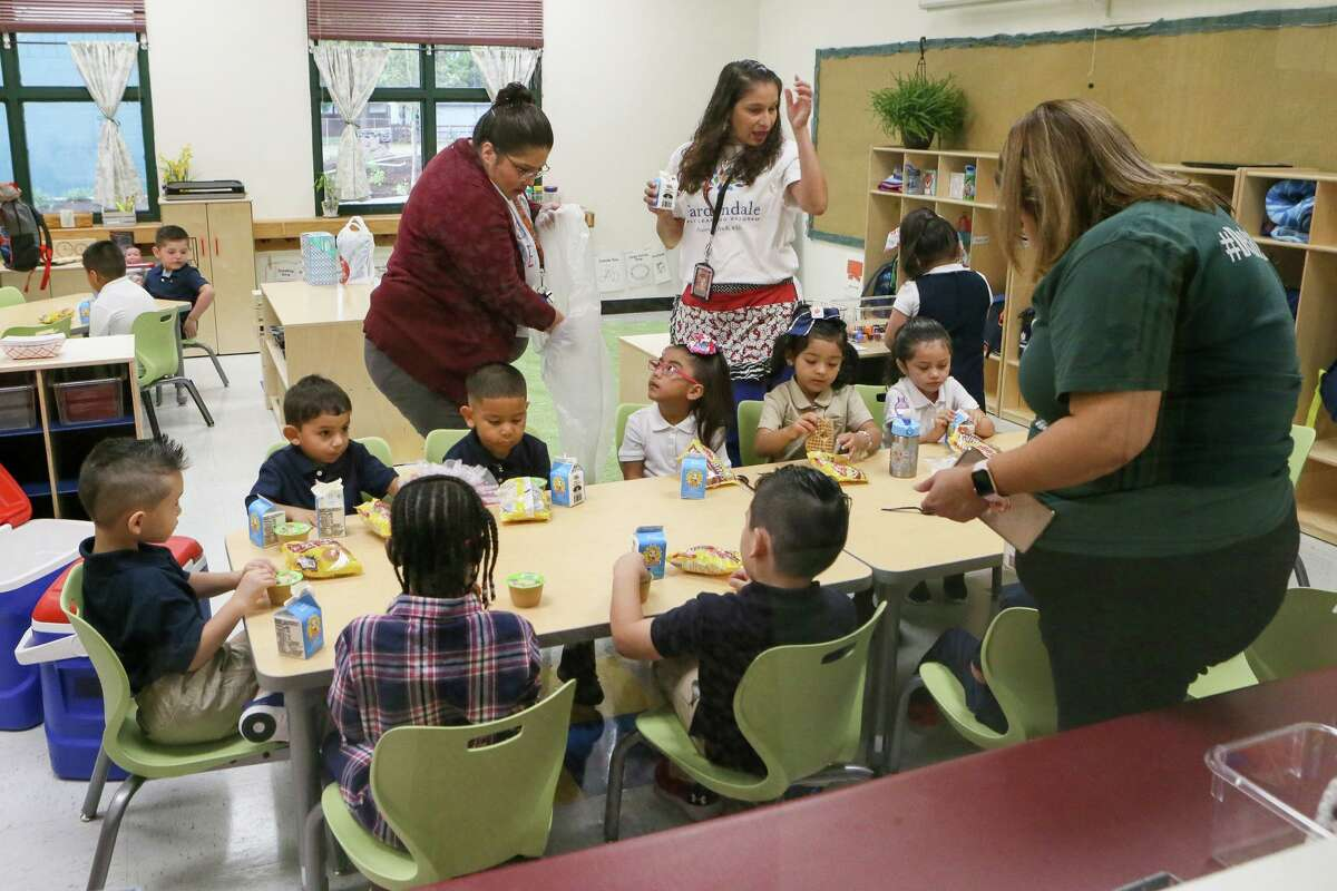 Pre-K students receive breakfast on the first day of school at Gardendale Elementary last August. Edgewood ISD has partnered with the city's Pre-K 4 SA program to turn the school into an early education center. Other school districts also are expanding preschool offerings. Eligibility to most public programs is based on household income, leaving access for middle class families a continuing problem.